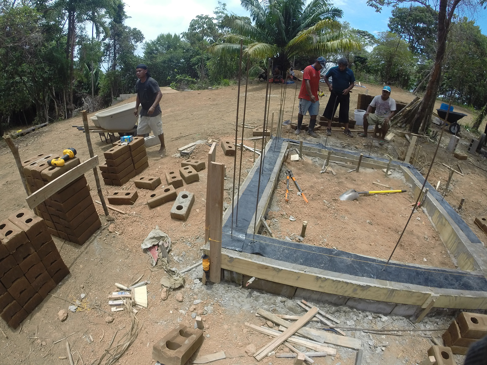 Compressed earth block building construction